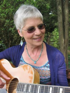 Carolyn playing her new Guild guitar. (Credit Keith Carreiro 2015.)