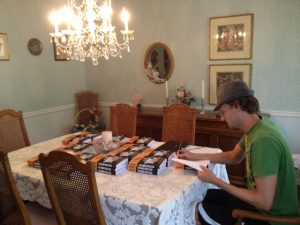 """""""First ever virtual book signing- the first time I ever signed books for loyal readers I was visiting my parents in Pittsburgh and signed the books at their dining room table, the table I grew up eating Thanksgiving and Christmas dinner at!"""" (Photo permission and courtesy of David Estes. Credit: Photo by Adele Estes, August 16, 2012, taken in Pittsburgh, Pennsylvania.)"""